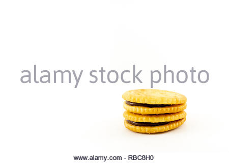 biscuit sandwich with chocolate cream isolated white background - Stock Image