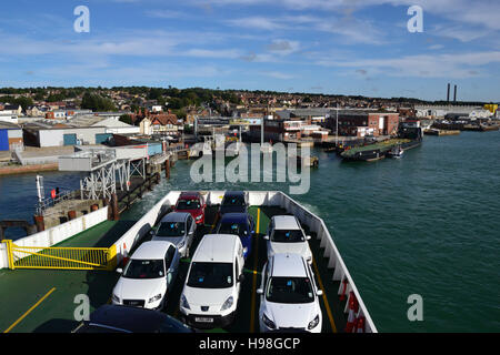 The car deck on a Red Funnel roll-on/roll-off car ferry approaching the ferry terminal at East Cowes on the Isle - Stock Image