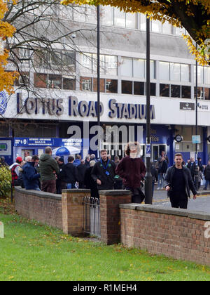 Crowds milling around Loftus Road Stadium before the start of the QPR and Brentford football game - Stock Image