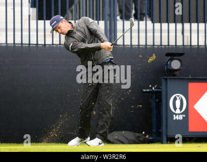 Portrush, County Antrim, Northern Ireland. 17th July 2019. The 148th Open Golf Championship, Royal Portrush Golf Club, Practice day ; Justin Rose (ENG) hits a short iron from the tee at the par three 13th hole Credit: Action Plus Sports Images/Alamy Live News - Stock Image