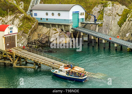 St Justinians Lifeboat stations, both old and new on the Pembrokeshire coast across the Bitches sea strait from Ramsey. - Stock Image