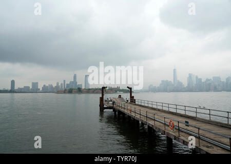 A view from Liberty Island in New York harbor, looking toward Ellis Island, Jersey City and Manhattan. June 25, 2019 - Stock Image