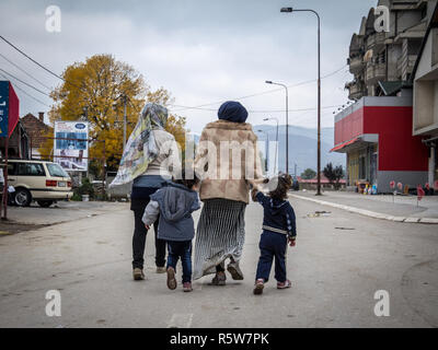 PRESEVO, SERBIA - OCTOBER 24, 2015: Two refugee women and their daughters on their way to register and enter Serbia at the border with Macedonia on Ba - Stock Image