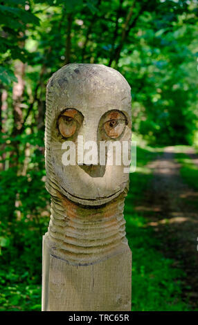 carved wooden face on timber post, pretty corner, sheringham, north norfolk, england - Stock Image