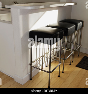 Three stools in the kitchen - Stock Image