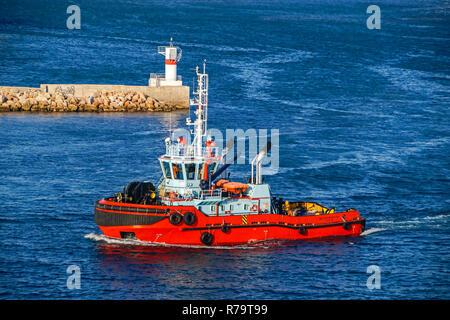 Tug boat megalochari VI at entrance to port of Piraeus Athens Greece Europe - Stock Image