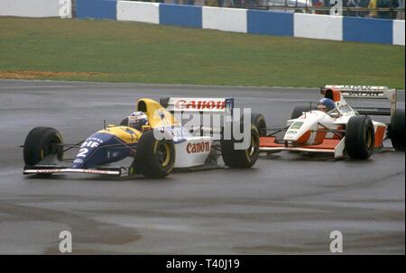 1993 European Grand Prix, Donington. Alain Prost in Williams Renault FW15C leads Derek Warwick in Footwork Mugen FA14 - Stock Image