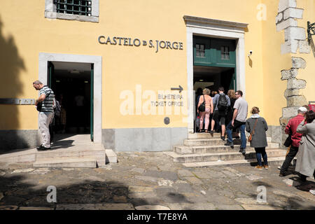 Line of tourists queue outside entrance to Castelo de Sao Jorge to buy tickets in Lisbon Portugal Europe EU  KATHY DEWITT - Stock Image