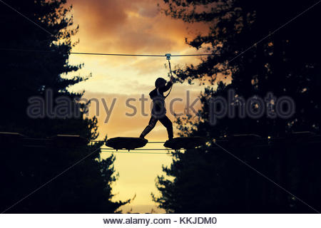 evening high ropes - Stock Image