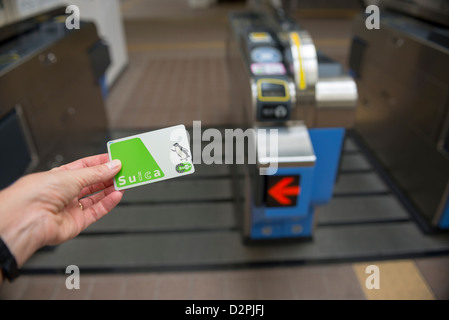 Stored value card Suica in front of a train entrance gate in Tokyo Japan - Stock Image