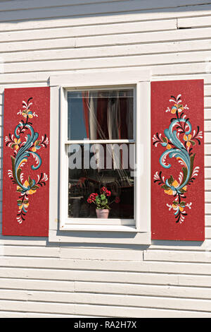 The Sons of Norway Hall Fedrelandet Lodge with painted rosemaling shutters in the tiny village of Petersburg on Mitkof Island, Alaska. Petersburg settled by Norwegian immigrant Peter Buschmann is known as Little Norway due to the high percentage of people of Scandinavian origin. - Stock Image