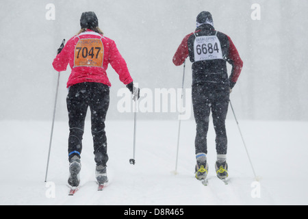 Heavy snow falls as competitors ski in the Mora Vasaloppet on February 10, 2013 near Mora, Minnesota. - Stock Image