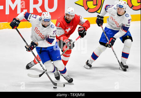 Bratislava, Slovakia. 15th May, 2019. L-R Andreas Martinsen (NOR), Vincent Praplan (CH) and Christian Bull (NOR) in action during the match between Switzerland and Norway within the 2019 IIHF World Championship in Bratislava, Slovakia, on May 15, 2019. Credit: Vit Simanek/CTK Photo/Alamy Live News - Stock Image