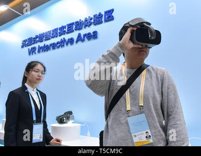 (190423) -- BEIJING, April 23, 2019 (Xinhua) -- A journalist tries virtual reality devices at the VR Interactive Area of the Media Center for the second Belt and Road Forum for International Cooperation in Beijing, capital of China, on April 23, 2019. The media center started trial operation at the China National Convention Center in Beijing Tuesday. More than 4,100 journalists, including 1,600 from overseas, have registered to cover the second Belt and Road Forum for International Cooperation to be held from April 25 to 27 in Beijing. (Xinhua/Li He) - Stock Image