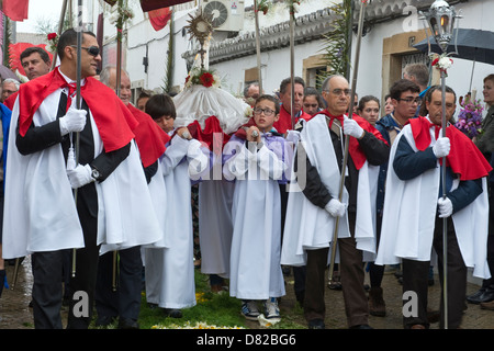 Boys and men taking part in the Flower Torches Festival Easter Sunday São Brás de Alportel Algarve Portugal - Stock Image