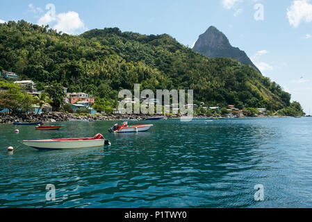 Boats on the Caribbean sea in the shadow of the Pitons; Saint Lucia - Stock Image