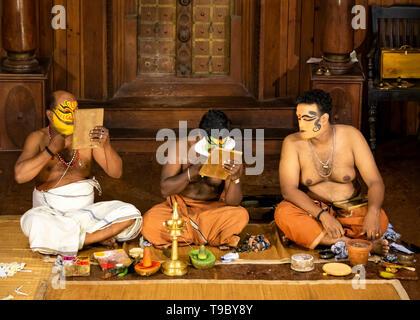 Horizontal view of Kathakali performers putting on their distinctive make up in Kerala, India. - Stock Image