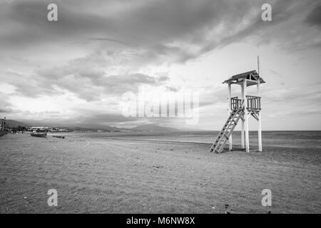 Life guard hut on a beach in black and white. - Stock Image