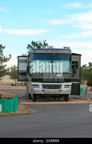Littleton, Colorado - A 'diesel pusher' motorhome hooked up at a campground at Chatfield Reservoir. - Stock Image