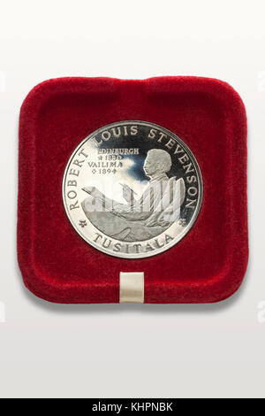 Robert Louis Stevenson silver coin in a red presentation tray - Stock Image