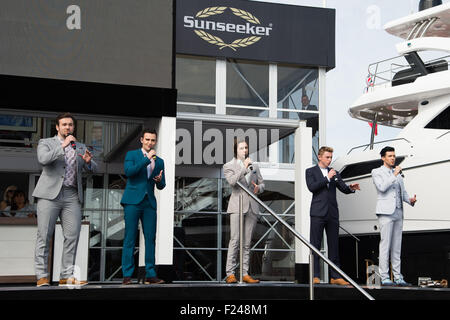 Southampton, UK. 11th September 2015. Southampton Boat Show 2015. Callibro open the Sunseeker stand on the opening - Stock Image