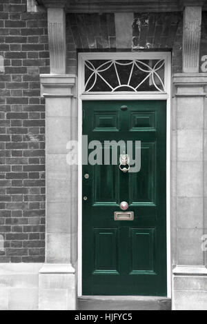 Grand antique green wooden door part of a home in London, England - Stock Image