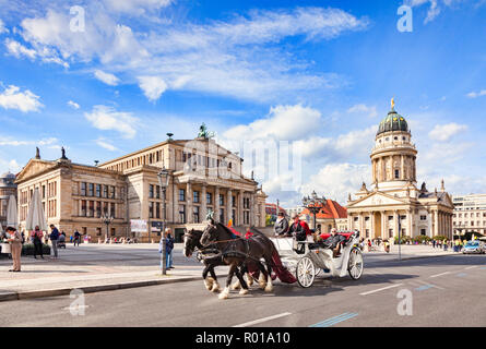22 September 2018: Berlin, Germany - Horse-drawn carriage ride in Gendarmenmarkt Square, with the Konzerthaus on the left and the French Church on the - Stock Image