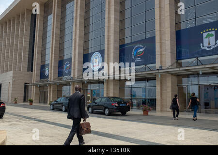 A man carrying a briefcase walks into the  modern international conference centre in Sipopo, Malabo, the capital of Equatorial Guinea - Stock Image