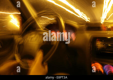 POV shot of a car driving on an ice-covered street, blurred. - Stock Image
