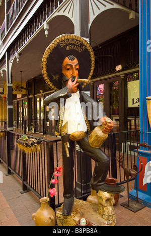 Mexican caballero or cowboy statue in full costume at Historic Market Square Mercado in downtown San Antonio, Texas - Stock Image