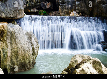 Aquatic waterfall in stone cliffs - Stock Image
