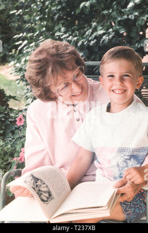 Grandmother Reads to Her Grandson, USA - Stock Image