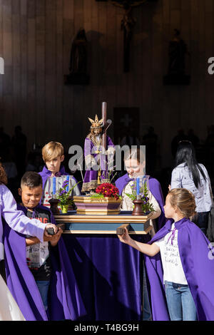 Pasión de Los Niños, Passion of the children,  Procesión de Los Pasos Chicos, Procession of the small stations of the cross,  leaving the church of Lo - Stock Image