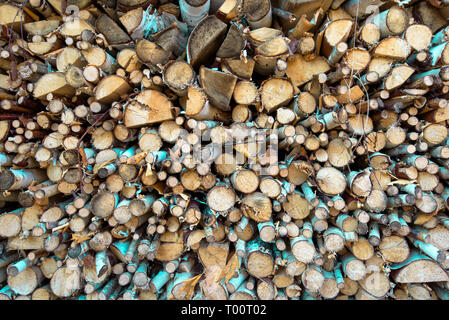 Stacked a large pile firewood, abstract natural wallpaper. - Stock Image