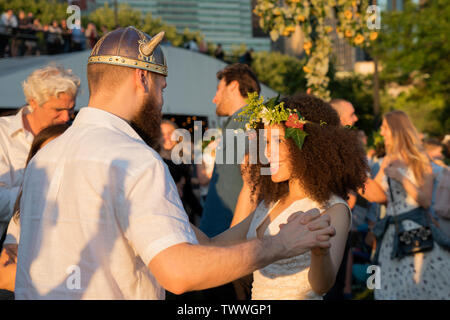 Dancing at the Swedish Midsummer Festival, held annually in Battery Park City's Wagner Park. It celebrates the summer solstice and St. John's Day. - Stock Image