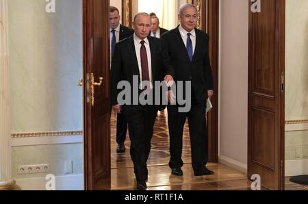 Moscow, Russia. 27th Feb, 2019. Russian President Vladimir Putin escorts Israeli Prime Minister Benjamin Netanyahu prior to their bilateral meeting at the Kremlin February 27, 2019 in Moscow, Russia. Credit: Planetpix/Alamy Live News - Stock Image