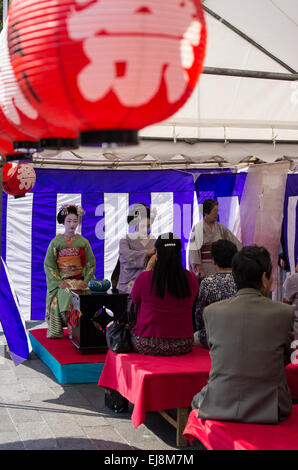 Two Geisha or Maiko at a Tea Ceremony at a local Street Festival in Kyoto, Japan - Stock Image