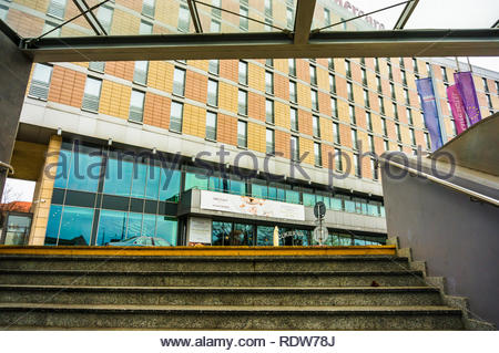 Poznan, Poland - November 21, 2018: Stairs with yellow mark leading from the Kaponiera underground passage to the Roosevelta street with Mercure Hotel - Stock Image