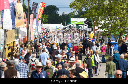 Ardingly Sussex UK 6th June 2019 - Crowds enjoy the first day of the South of England Show held at the Ardingly Showground in Sussex. The annual agricultural show highlights the best in British farming and produce and attracts thousands of visitors over three days . Credit : Simon Dack / Alamy Live News - Stock Image