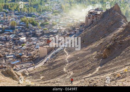Man climbing up to Tsemo Gompa from Leh Palace, Leh, Ladakh, India - Stock Image