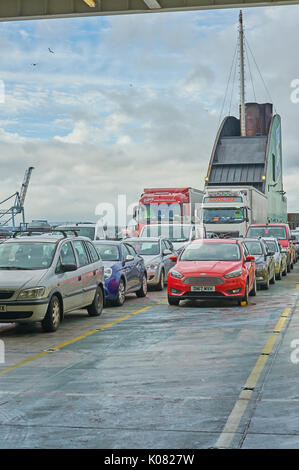 Cars parked on the outer deck of a passenger car ferry awaiting departure from Dublin Port, Ireland - Stock Image