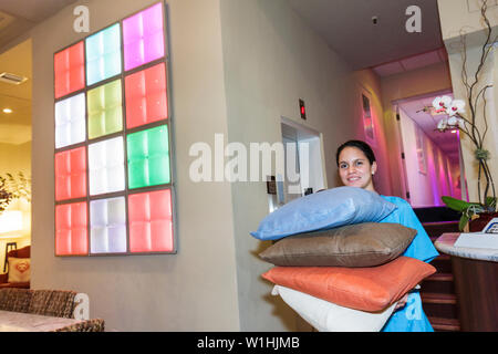 Miami Beach Florida Collins Avenue Circa 39 Hotel boutique lodging accommodation decor lobby Hispanic woman housekeeping staff - Stock Image