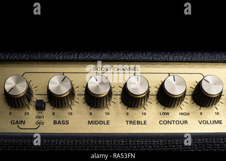 vintage amplifier six knobs horizontal closeup, isolated, copy space on top, old - Stock Image