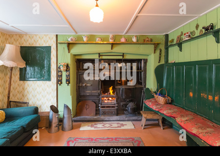 Farmhouse Living Room with Fire and Range Beamish Living Open Air Museum - Stock Image