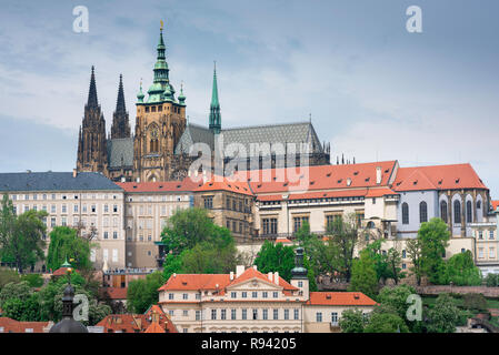 Prague castle cathedral, view of the Hradcany district with the Prague Castle buildings and the roof and spires of St Vitus Cathedral on the skyline. - Stock Image