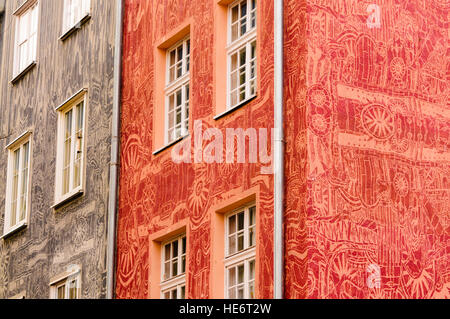 Buildings with ornate murals painted on their outsides in Gdansk, Poland. - Stock Image