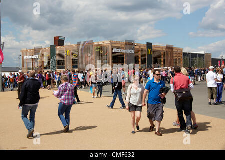 People walking in front of a MacDonalds Restaurant on a sunny day at Olympic Park, London 2012 Olympic Games site, - Stock Image