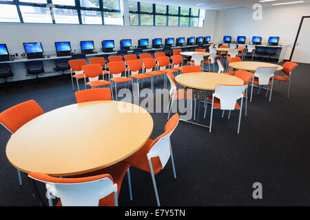 Unoccupied library with computers around the walls at Teddington Sixth Form College. - Stock Image