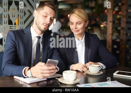 Scrolling at break - Stock Image