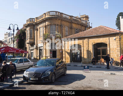 Taxi stand and colonial buildings near the Ataturk square in the northern part of Nicosia Cyprus - Stock Image